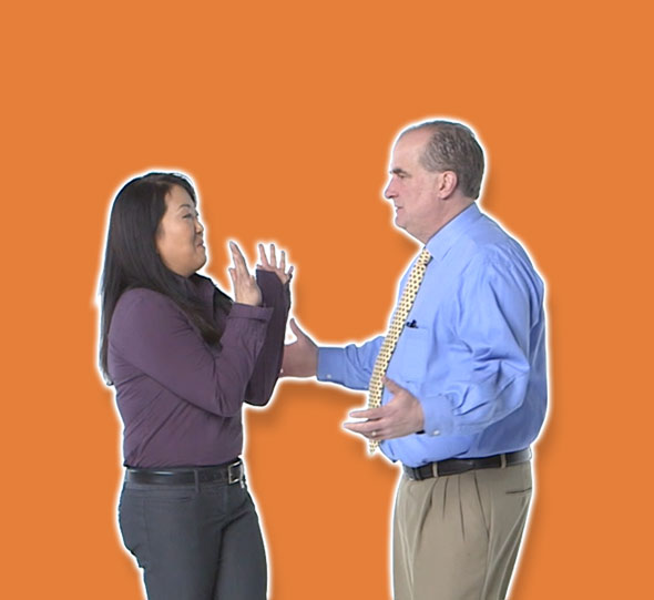 man approaching woman orange background
