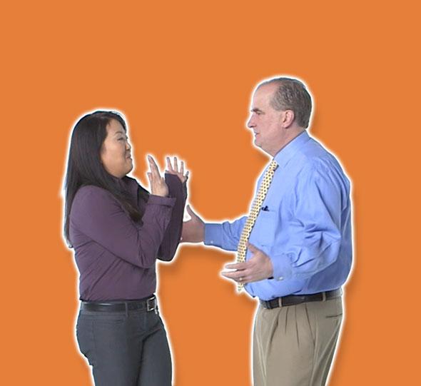 man approaching woman orange background